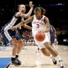 OU\'s Courtney Paris drives past Pittsburgh\'s Pepper Wilson during the NCAA women\'s basketball tournament game between Oklahoma and Pittsburgh at the Ford Center in Oklahoma City, Sunday, March 29, 2009. PHOTO BY BRYAN TERRY, THE OKLAHOMAN