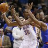 Photo - Oklahoma City Thunder forward Kevin Durant (35) is pressured by New York Knicks guard Raymond Felton (2) in the first quarter of an NBA basketball game in Oklahoma City, Sunday, Feb. 9, 2014. (AP Photo/Sue Ogrocki)