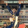 Photo - Chase Elliott celebrates after winning NASCAR Nationwide Series auto race at Texas Motor Speedway in Fort Worth, Texas, Friday, April 4, 2014. (AP Photo/Larry Papke)