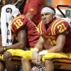 Photo - Iowa State wide receiver Orion Salters (21) and teammate Jauan Wesley (18) sit in the bench during the second half of an NCAA college football game against North Dakota State, Saturday, Aug. 30, 2014, in Ames, Iowa. North Dakota State won 34-14. (AP Photo/Charlie Neibergall)