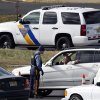 A New Jersey state trooper talks to a motorist at the Thomas A. Edison service area on the New Jersey Turnpike Saturday, Nov. 3, 2012, near Woodbridge, N.J., as troopers keep order while motorist line up to purchase gasoline. From storm-scarred New Jersey to parts of Connecticut, a widespread lack of gasoline added to the frustration since Superstorm Sandy passed through the area. Gas rationing was to starting at noon Saturday in northern New Jersey, where drivers will be allowed to buy it only every other day. (AP Photo/Mel Evans)