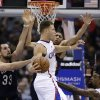 Photo - Los Angeles Clippers' Blake Griffin, center, passes the ball as New Orleans Pelicans' Ryan Anderson, left, and Anthony Davis defend during the first half of an NBA basketball game Wednesday, Dec. 18, 2013, in Los Angeles. (AP Photo/Jae C. Hong)