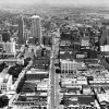OKLAHOMA CITY / SKYLINE / AERIAL VIEW: Aerial view of downtown Oklahoma City looking east along Main Street from about Shartel Avenue. Bekins Storage (right foreground) was located at 706 W. Main; Clark Motor Co. (left foreground) was located at 115 N. Shartel. Corner of the Civic Center can be seen at lower left. Staff photo by Jim Lucas taken 8/30/1955; photo ran in the 9/5/1955 Daily Oklahoman.