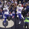 Buffalo Bills free safety Jairus Byrd (31) celebrates with teammate Da\'Norris Searcy (25) after intercepting a pass during the second half of an NFL football game Thursday, Nov. 15, 2012 in Orchard Park, N.Y. The Bills won the game 19-14. (AP Photo/Bill Wippert)