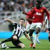 Photo -   Newcastle United's Mike Williamson, left, vies for the ball with Manchester United's Danny Welbeck, right, during their English Premier League soccer match at the Sports Direct Arena, Newcastle, England, Sunday, Oct. 7, 2012. (AP Photo/Scott Heppell)