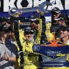 Driver Matt Kenseth holds up the trophy as the celebrates in Victory Lane after winning the NASCAR Sprint Cup Series auto race, Sunday, March 10, 2013 in Las Vegas. (AP Photo/Julie Jacobson)