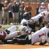 Oklahoma State\'s Joseph Randle (1) stretches for a touchdown as Texas\' Blake Gideon (21) defends during first half of a college football game between the Oklahoma State University Cowboys (OSU) and the University of Texas Longhorns (UT) at Darrell K Royal-Texas Memorial Stadium in Austin, Texas, Saturday, Oct. 15, 2011. Photo by Sarah Phipps, The Oklahoman