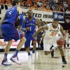 Oklahoma State \'s Marcus Smart (33) drives past Kansas\' Jeff Withey (5) and Naadir Tharpe (1) during the college basketball game between the Oklahoma State University Cowboys (OSU) and the University of Kanas Jayhawks (KU) at Gallagher-Iba Arena on Wednesday, Feb. 20, 2013, in Stillwater, Okla. Photo by Chris Landsberger, The Oklahoman