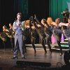 """Josh Masterson sings """"Can\'t Buy Me Love."""" during the Edmond Memorial Follies Saturday Jan. 25, 2014. Photo by M. Tim Blake, for The Oklahoman"""