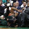 Milwaukee Bucks\' Caron Butler (3) falls into the Milwaukee bench while trying to keep the ball in bounds during the first quarter of an NBA basketball game against the Boston Celtics in Boston, Friday, Nov. 1, 2013. (AP Photo/Michael Dwyer)