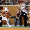 Oklahoma State\'s Charlie Moore (17) catches a touchdown pass in front of UT\'s Duke Thomas (21) in the third quarter during a college football game between the Oklahoma State University Cowboys (OSU) and the University of Texas Longhorns (UT) at Darrell K Royal - Texas Memorial Stadium in Austin, Texas, Saturday, Nov. 16, 2013. Photo by Sarah Phipps The Oklahoman