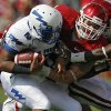 Oklahoma\'s Tom Wort (21) stops Air Force\'s Tim Jefferson (7) during the first half of the college football game between the University of Oklahoma Sooners (OU) and the Air Force Falcons at the Gaylord Family - Memorial Stadium on Saturday, Sept. 18, 2010, in Norman, Okla. Photo by Chris Landsberger, The Oklahoman