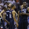 Charlotte Bobcats\' Al Jefferson (25) talks with Kemba Walker, left, Josh McRoberts, second from left, and Gary Neal (12) during the second half in Game 1 of an opening-round NBA basketball playoff series against the Miami Heat, Sunday, April 20, 2014, in Miami. The Heat defeated the Bobcats 99-88. (AP Photo/Lynne Sladky)