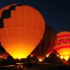 Photo - Balloonists fire their burners during Balloon Glow  on the second day of the annual Albuquerque balloon fiesta Sunday Oct. 6, 2013 in Albuquerque, N.M. (AP Photo/The Albuquerque Journal, Adolphe Pierre-Louis)  THE SANTA FE NEW MEXICAN OUT