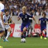 Photo - Japan's Keisuke Honda, center, controls the ball against Cyprus during a friendly soccer match in Saitama, north of Tokyo, Tuesday, May 27, 2014. Japan will play against Ivory Coast, Greece and Colombia in Group C of the World Cup 2014 in Brazil. (AP Photo/Shuji Kajiyama)
