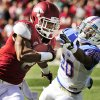 Arkansas wide receiver Julian Horton (2) tries to get around Tulsa defensive back Marco Nelson (20) during the first quarter of an NCAA college football game in Fayetteville, Ark., Saturday, Nov. 3, 2012. (AP Photo/April L. Brown)