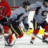 Calgary Flames\' Mikael Backlund, center, from Sweden, chases the puck during training camp in Calgary, Alberta, Monday, Jan. 14, 2013. (AP Photo/The Canadian Press, Jeff McIntosh)