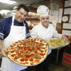 Photo - Danny Falcone holding an Italian sausage and pepperoni pizza and Phil Custino holding a pan of lasagna at Falcone's Pizzeria and Deli in Oklahoma City Tuesday, Dec. 13, 2011. Photo by Paul B. Southerland, The Oklahoman ORG XMIT: KOD