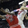 Photo - Chicago Bulls' Jimmy Butler (21) is fouled by Houston Rockets' Chandler Parsons (25) in the first half of an NBA basketball game on Wednesday, Dec. 18, 2013, in Houston. (AP Photo/Pat Sullivan)