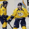 Nashville Predators center Colin Wilson (33) celebrates with David Legwand (11) after Wilson scored in overtime to give the Predators a 1-0 win over the San Jose Sharks in an NHL hockey game Tuesday, Feb. 12, 2013, in Nashville, Tenn. (AP Photo/Mark Humphrey)