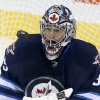 Photo - Winnipeg Jets goaltender Al Montoya (35) juggles a New Jersey Devils shot during first period NHL hockey action in Winnipeg, Manitoba, Sunday, Oct. 13, 2013. (AP Photo/The Canadian Press, Trevor Hagan)