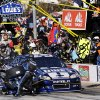 Jimmie Johnson has his car serviced during the NASCAR Sprint Cup Series auto race, Sunday, Nov. 4, 2012, in Fort Worth, Texas. (AP Photo/Tony Gutierrez)