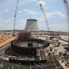 Photo - FILE- In this June 13, 2014 file photo, construction continues on a new nuclear reactor at Plant Vogtle power plant in Waynesboro, Ga. The delays in the nuclear industry are adding up, adding hundreds of millions of dollars to already expensive projects. The latest announcement came from SCANA Corp., which expects a year-long delay in the completion of its two reactors under construction in South Carolina. That announcement raised questions about whether an identical plant under construction by the same builders in Georgia will also see expensive delays. (AP Photo/John Bazemore, File)