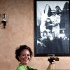 Photo - VITO'S RISTORANTE / ITALIAN FOOD: Cathy Cummings poses under a picture of her Uncle Vito at her restaurant called Vito's in Oklahoma City on Tuesday, Oct. 13, 2009. By John Clanton, The Oklahoman ORG XMIT: KOD