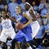Delaware\'s Elena Delle Donne, front, drives around North Carolina forward Xylina McDaniel (34) and center Waltiea Rolle during the first half of a second-round game in the women\'s NCAA college basketball tournament in Newark, Del., Tuesday, March 26, 2013. (AP Photo/Patrick Semansky)