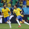 Photo - Brazil's Neymar, right, celebrates with teammate Hulk after scoring during the group A World Cup soccer match against Croatia in the opening game of the tournament at Itaquerao Stadium in Sao Paulo, Brazil, Thursday, June 12, 2014. (AP Photo/Frank Augstein)