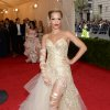 """Rita Ora attends The Metropolitan Museum of Art\'s Costume Institute benefit gala celebrating """"Charles James: Beyond Fashion"""" on Monday, May 5, 2014, in New York. (Photo by Evan Agostini/Invision/AP)"""