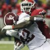 Alabama running back Eddie Lacy (42) is hit by Georgia safety Shawn Williams (36) during the first half of the Southeastern Conference championship NCAA college football†game, Saturday, Dec. 1, 2012, in Atlanta. (AP Photo/Jamie Martin)
