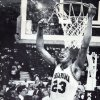 Former OU basketball player Wayman Tisdale. KANSAS CITY, MO., March 9. Wayman Tisdale is the center of attention by his teammates as he snips away at the net following the Sooner\'s victory over Iowa State in the Big eight Championship Saturday. Photo by Doug Hoke 1985. OPUBCO cutline - One more honor for Wayman Tisdale: Cutting down the Big Eight tourney nets. Photo taken 3/9/1985, Photo published 3/10/1985 in The Daily Oklahoman Staff Photo by Doug Hoke ORG XMIT: KOD