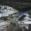 Photo - This aerial photo shows derailed train cars burning in Plaster Rock, New Brunswick  on Wednesday, Jan. 8, 2014.  A Canadian National Railway freight train carrying crude oil and propane derailed Tuesday night in a sparsely populated region of northwestern New Brunswick.  More than 100 residents remained evacuated from their homes. There were no deaths or injuries. (AP Photo/The Canadian Press, Tom Bateman)