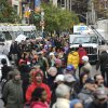 A long line of people wait for free distribution of dry ice in Union Square in the still powerless Chelsea section of Manhattan,Thursday, Nov. 1, 2012, in New York. Three days after superstorm Sandy walloped the city, residents and commuters still faced obstacles as they tried to return to pre-storm routines. (AP Photo/ Louis Lanzano)