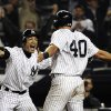 New York Yankees\' Ichiro Suzuki, left, of Japan, celebrates with Francisco Cervelli (40) after Cervelli scored on an RBI single from Raul Ibanez during the 12th inning of a baseball game, Tuesday, Oct. 2, 2012, in New York. The Yankees won 4-3. (AP Photo/Frank Franklin II)