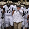 Purdue interim coach Patrick Higgins leads his team onto the field before the Heart of Dallas Bowl football game between Oklahoma State University and Purdue University at the Cotton Bowl in Dallas, Tuesday, Jan. 1, 2013. Oklahoma State won 58-14. Photo by Bryan Terry, The Oklahoman
