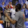 Fans try to get the attention of Oklahoma City\'s James Harden before Game 3 of the first round in the NBA playoffs between the Oklahoma City Thunder and the Dallas Mavericks at American Airlines Center in Dallas, Thursday, May 3, 2012. Photo by Bryan Terry, The Oklahoman