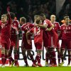 Photo - Bayern's Toni Kroos, left, celebrates with the team after scoring his side's first goal during the first division Bundesliga soccer match between Hertha BSC and FC Bayern Munich in Berlin, Tuesday, March 25, 2014. (AP Photo/Markus Schreiber)