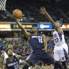 Charlotte Bobcats guard Kemba Walker (15) drives to the basket against Sacramento Kings defender Isaiah Thomas (22) during the first half of an NBA basketball game in Sacramento, Calif., on Saturday, Jan. 4, 2014. (AP Photo/Steve Yeater)