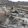 Martin Jiles looks over the ashes of his home that was destroyed by the High Park Fire in the Glacier View residential area near Livermore, Colo., on Monday, July 2, 2012. The last evacuees from the fire in have been allowed to return home as crews fully contained the136-square-mile wildfire that killed one resident and destroyed 259 houses. (AP Photo/Ed Andrieski) ORG XMIT: COEA101