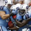 Photo - Tennessee Titans' Alterraun Verner, center, celebrates with teammates after he returned an interception for a touchdown against the Houston Texans during the fourth quarter of an NFL football game on Sunday, Sept. 15, 2013, in Houston. (AP Photo/Patric Schneider)