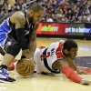 Orlando Magic guard Jameer Nelson (14) grabs the loose ball in front of Washington Wizards guard John Wall (2) in the first half of an NBA basketball game Monday, Jan. 14, 2013 in Washington. (AP Photo/Alex Brandon)