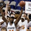 OSU\'s Tony Allen holds up the Big 12 tournament MVP award after winning the 2004 conference title. / Staff photo by Bryan Terry.