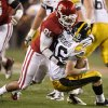 Oklahoma\'s R.J. Washington (91) Iowa\'s James Vandenberg (16) during the Insight Bowl college football game between the University of Oklahoma (OU) Sooners and the Iowa Hawkeyes at Sun Devil Stadium in Tempe, Ariz., Friday, Dec. 30, 2011. Photo by Bryan Terry, The Oklahoman