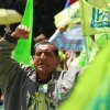 Photo -   A supporters of Ecuador's President Rafael Correa cheers at an Alianza Pais convention rally where Correa announced his re-election bid for the upcoming February election and introduced his running mate Jorge Glas, former minister of Strategic Coordination, in Quito, Ecuador, Saturday, Nov. 10, 2012. (AP Photo/Martin Jaramillo)