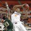 Oklahoma State \'s Le\'Bryan Nash (2) drives against South Florida Bulls\' Kore White (33) during the college basketball game between Oklahoma State University (OSU) and the University of South Florida (USF) on Wednesday , Dec. 5, 2012, in Stillwater, Okla. Photo by Chris Landsberger, The Oklahoman