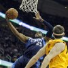 Dallas Mavericks\' Vince Carter (25) shoots against Cleveland Cavaliers\' Tyler Zeller in the first quarter of an NBA basketball game on Saturday, Nov. 17, 2012, in Cleveland. (AP Photo/Mark Duncan)