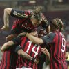 Photo - AC Milan midfielder Valter Birsa, covered by his teammates, of Slovenia, celebrates after scoring during the Serie A soccer match between AC Milan and Sampdoria at the San Siro stadium in Milan, Italy, Saturday, Sept. 28, 2013. (AP Photo/Antonio Calanni)