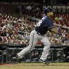 Photo - Milwaukee Brewers' Khris Davis watches his RBI triple during the 12th inning of a baseball game against the St. Louis Cardinals Monday, April 28, 2014, in St. Louis. The Brewers won 5-3 in 12 innings. (AP Photo/Jeff Roberson)
